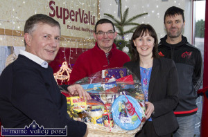 Garvey's SuperValu, Castleisland branch Manager, Margaret Ryan and staff member, John O'Donoghue presenting Christmas Hampers to incoming Castleisland Members' Golf Club Captain, John Manton (left) with club member, Jonathan Kelliher at the Mill Road store on Monday. ©Photograph: John Reidy