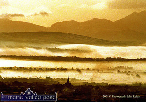 On a Clear Day:  The spire of the Church of Saints Stephen and John is the one recognisable feature from Glounsharoon as Castleisland and the Maine Valley are enveloped in early morning fog. ©Photograph: John Reidy  30-12-2001