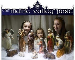 O Holy Night: The Hartnett sisters with their street-facing crib on the Limerick Road side of Hartnett's Corner on this special evening. Little Nell Hartnett is pictured with her sisters, Lizzie Mai and Nora Ann as they put the Baby Jesus in his crib on this holy night.  ©Photograph: John Reidy