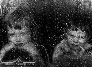 Rain Stops Play: Micheál Reidy (left) and Thomas Hayes show their displeasure at summer downpoour at No. 4 Tralee Road, Castleisland.  ©Photograph: John Reidy 1983