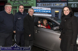 Tralee Credit Union Car Draw winner, Dolores O'Reilly trying out her new car as she receives the keys from Derry Fleming, Tralee Credit Union outside her local office in Castleisland this morning with: Dan O'Sullivan, Jerry O'Sullivan, Kelliher's Garage, Tralee and Suzanne Ennis, Marketing and Business Development Manager, Tralee Credit Union. ©Photograph: John Reidy
