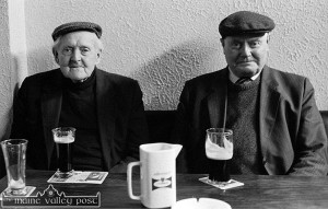 The late Paddy Maher, Kilbanivane (right) with the late John Joe O'Connell, Kilally  taking a drop at Jimmy Kearney's Bar, Castleisland after mass on a Sunday in February 1999.  ©Photograph: John Reidy  28-2-1999