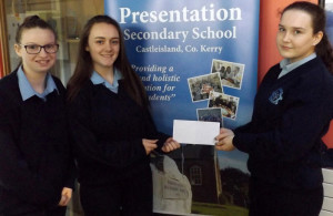 Shauna O'Donoghue (right) a member of the Presentation Secondary School Transition Year Credit Union team presenting Young Scientists qualifying team members: Gillian Hanifan (left) and Molly O'Callaghan with a sponsorship package to help with their trip to the finals in Dublin.