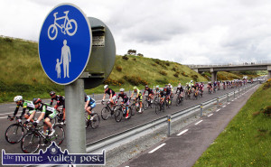 2014: An Post RÁS cyclists heading down the N21 Castleisland Bypass on Stage 4 from Charleville  to Caherciveen. ©Photograph: John Reidy  21-5-2014