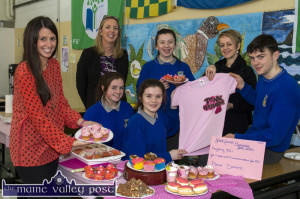 Teachers and students at Castleisland Community College laying out their stall during the recent Breast Cancer Awareness Bake Sale included are: Elaine Murphy, tracher with: Cara Twomey, Saoirse Casey and Seán O'Connell. Back from left: Teresa Lonergan, deputy principal; Grace McCarthy and Carmel Kelly, principal.  ©Photograph: John Reidy