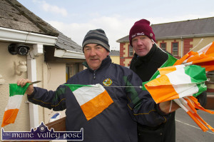 Charlie Farrelly (left) and Ted Kenny out on 'Bunting Duty' in Castleisland ahead of last year's big parade in Castleisland. ©Photograph: John Reidy 15-3-2015