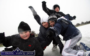 More like winter weather:  Castleisland boys, from left: Evan O'Brien, Ryan Broderick, Darren Maunsell and his brother Jamie (back) adapting well to the extreme winter conditions on a frozen pool of water on Tom Horan's land at Inch in Castleisland. ©Photograph: John Reidy 10-1-2010