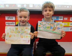 Nohoval National School pupils, Kyran Boyle (left) and Jack Lynch pictured with their Doodle for Google entries - for which the're looking for your votes to help them win.  Photograph Courtesy of Nohoval National School