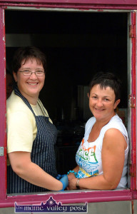 The late Mary Cotter (left) and Ellen Barrett doing their shift in the Knocknagoshel GAA Club fundraising 'Burger Hut' during the 2004 Pattern Day Sports at Willie Walsh Memorial Park. ©Photograph: John Reidy 15-8-2004