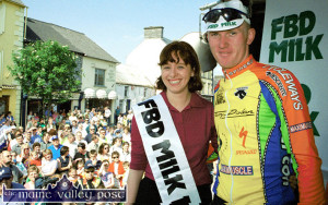 Listowel cyclist Eugene Moriarty of the Meath Cycleways Team is congratulated by FBD Milk RÁS Queen, Monica O'Sullivan from Currow on his third place finish into Castleisland after the 2001 stage finish. ©Photograph: John Reidy 22-5-2001
