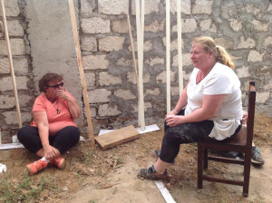 Hannah Curtin (right) on a tea-break with an un-named colleague on site in Kenya.