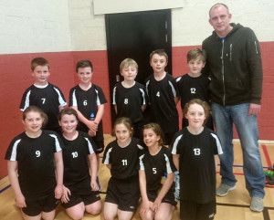 Ballymacelligott U-11 Community Games silver medal winning basketball team with Coach Mike Broderick. Included are: Aoibhinn Broderick, Orla O Connor, Ciara Palmer, Ellie Quirke, Roisin Rahilly, Evan Boyle, Niall Collins, Tom Long, David Lucid, Micheal Savage.