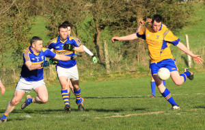 Ballymac's Shane Dowling shoots for a score as Cordal defenders, John Brosnan and Micheál Cahill move in to block during Saturday evening's game in Ballymacelligott. Photograph: Tom O'Donoghue.