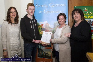 Scholarship winner, Pádraig Blanchfield being presented with his pleasant surprise by Irish Host Family founder, Antoinette Butler with Coirnelia Riepshoff (left) and Pádraig's mom, Helen at the IHF office in Castleisland on Tuesday evening. ©Photograph: John Reidy