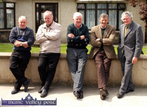 After mass meeting:  The late Con O'Connor (second from right) with neighbours from left: Denis Lyons, John Buckley, Paddy O'Connor and Tom Horan at their traditional meeting place on McGaley's wall on Church Street after Sunday.  ©Photograph: John Reidy 15/05/2005