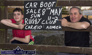 Castleisland RFC Car Boot Sale organiser, Brian O'Sullivan with his son Conor as they postered the area on Thursday evening for Sunday's big event at The Crageens. ©Photograph: John Reidy