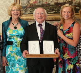 President Michael D and Sabina Higgins receiving the set of carved, white marble bookends from Castleisland artist, Kate Shanahan at Áras an Úachtaráin in July 2013.