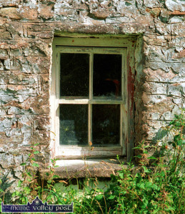 A view of a rapidly disappearing form of vernacular architecture. This window from an old dwelling house in Keel. ©Photograph: John Reidy