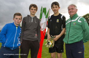 Shane Coffey, Leo O'Connor, Páraic O'Connor and Georgie O'Callaghan collecting the flags after the 2015 Castleisland KDYS / Garda Soccer League. ©Photograph: John Reidy