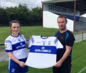 Former Desmonds player and captain, Niall O'Connor pictured with his daughter Kate and one of the set of jerseys he sponsored and presented to the ladies last evening. Photograph: Gerdie Murphy