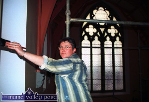 The late Noreen Sheehy, Lyreacrompane and Killarney working as a Painter and Decorator for the Millstreet based Forde firm at the Church of Saints Stephen and John in Castleisland in 2002.  ©Photograph: John Reidy 19/07/2002