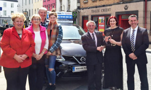 Luck strikes twice for one Tralee family.  Linda O'Connor receiving the keys to her brand new Nissan Pulsar from Derry Fleming, Tralee Credit Union. Also in the photo her parents Peter and Marie O'Connor, sister Siobhan, family friend, Sheila Fitzgerald and David Randles, Randles Bros.