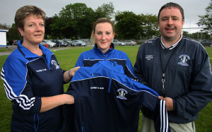 Betty O'Connell, Kearney's Bar (left) presenting a set of training gear to Desmonds Senior Ladies Captain, Rachel Cronin and Manager,Tommy Dom O'Connor. Photograph: Pat Hartnett.