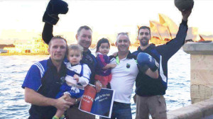 Castleislanders, Kevin and Finn Lynch (left) pictured with Barry Dillon, Bella and Tim Broderick and Flor Lynch lending their support to The Brawl in the Hall in with the Sydney Opera House as a backdrop.