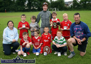 Shane as captain of the Desmonds Avenue U-10 soccer team which emerged as the 2007 Garda / KDYS Soccer League Champions at Limerick Road. Included are: Geraldine O'Sullivan, KDYS; Brian Leonard, Ben Cooney, Shane McLoughlin, Captain; Kevin Neligan and Sgt. John O'Mahony, competition founder. Back from left: Charlie Cooney, Kevin Keane, Síle Kerley, Coach; Matthew Browne and Aaron Nolan.  ©Photograph: John Reidy  29/06/2007