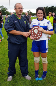 Frank McLoughlin of the Kerry Ladies County Board presenting the U-14 County League Trophy to Castleisland Desmonds captain, Áine Sheehan.