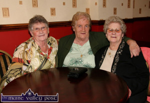 Together again: The late Sheila McCarthy (centre) pictured with her Desmonds Avenue neighbours, the late Betty Hayes (right) who was celebrating her 80th birthday at The Crown Hotel on the occasion and the late Eily O'Sullivan.  ©Photograph: John Reidy