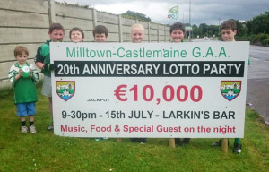 Young Milltown/Castlemaine GAA Club supporters promoting their club's lotto anniversary jackpot.