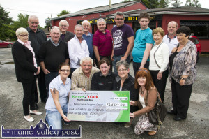 Organisers, committee members and friends of the annual Castleisland Vintage Run pictured at the presentation of the cheque to representatives of the Kerry Cancer Support Group / Kerry Cork Health Link Bus at The Half-Way Bar in Ballymacelligott. Included are front: Sandra O'Connor, Noel O'Connor, event founder; Trish Kelly and Breda Dyland, Kerry Cancer Support Group / Kerry Cork Health Link Bus and Margaret O'Connor, committee member. Back row from left: Noan Horan, Mike Harrington, Donal McGlynn, Cllr. Pat McCarthy, Joe O'Connor, Timmy O'Connor, Larry Keane, Seamus and Cody Shanahan, Eileen Somers, Frank O'Connor and Margaret Prendiville. ©Photograph: John Reidy