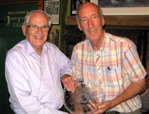 Seán Ó Sé is presented with the Dan Paddy Andy Plate by Joe Harrington at the launch in John B Keane's Bar on Friday night.