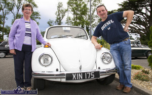 Mrs. Bridget Jones, Glountane met Willie O'Connell the current owner of the 1971 VW Beetle which was owned by her late husband, Paddy and in which she learned to drive at that time. They are pictured at the start of the Kingdom Veteran Vintage & Classic Car Club and Honda Charity Run at Ó Riada's Bar and Restaurant, Ballymacelligott on Friday evening. ©Photograph: John Reidy