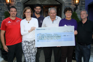 Brian (left) and Ann Maria Pembroke of Down Syndrome Ireland with: Dave Curran, chairman of the Kingdom Veteran Vintage & Classic Car Club and event organisers:  Peter O'Connor, Joan and George Glover at the presentation of the cheque at Friday evening's annual run. Photograph: Pat Hartnett.