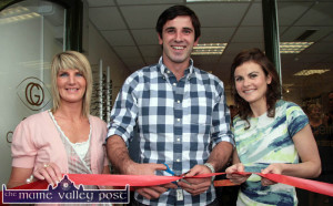 John Galvin performing  the official opening dutiesat  Galvin Optometrists with his cousin and proprietor, Maria Galvin (right) and her assistant, Sinead Cahill on August 6-2011 ©Photograph: John Reidy