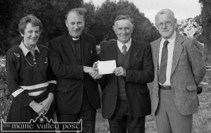 In his capacity of Cordal Parish Clerk, the late Sonny Boyle made a presentation to the late Fr. Kieran O'Shea, CC on the announcement of his leaving the parish to take up his appointment as Knocknagoshel PP. Included are: Monica Prendiville and the late Paddy Brosnan, NT at a mass in Kilmurry Cemetery. ©Photograph: John Reidy 9-7-1990