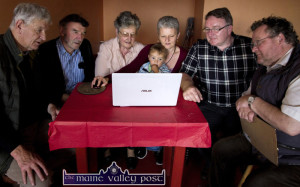 At the launch of the Michael O'Donohoe Memorial Heritage Project website were from left: Tomo Burke, committee treasurer; Johnnie Roche, chairman; Breda Brooks, the late Mr O'Donohoe's sister; Janet Murphy, project manager with her grand-son, Damon Farkas-Murphy; T.J. Mahony, Kerry County Council Heritage Officer and Colm Kirwan, committee secretary. ©photograph: John Reidy