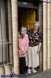 Sisters and retired grocers / publicans, Marion RIP (left) and Doris Fitzmaurice standing in respect at 104 Upper Main Street, Castle Island as the funeral of the late Con Houlihan passed their door in September 2012. ©Photograph: John Reidy  7-9-2012