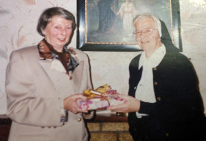 The late Marion Fitzmaurice receiving a presentation from the late Sr. Rita Donegan to mark the 50th anniversary of her involvement with Castleisland Parish Choir on October 19th. 1998.