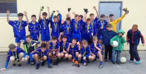 The Ballymac U-13 team celebrate after their win in the Rose Shield on Saturday evening.