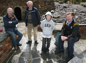 Currow Rural Development Association members from left: brothers, Dermot and Seán O'Leary, Paul O'Connor and his dad, Peter pictured at their just restored Lime Kiln in the townland of Droumore in 2010. ©Photograph:  John Reidy