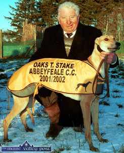 The late Dave Cahill, after whom Castleisland Coursing Club grounds Cahill Park is named, holding Marryville Lizzie after she won the Oaks Trial Stake at Abbeyfeale Coursing Club meeting in December 2001. ©Photograph: John Reidy 30-12-2001