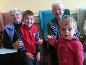 Julia Moriarty (left) and Bernadette Leahy enjoying the company of Zachari Georgiev and Jack O Connor of Bright Beginnings Pre-School when the boys visited Castleisland Day Care Centre care this week.