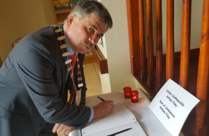 Kerry County Council Chairman, Michael O'Shea signing the book today. Photograph Courtesy of Kerry County Council.