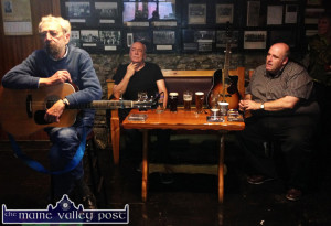 Mickey MacConnell introducing one of his songs at Saturday's singing session with fellow guests, Tim Dennehy and Don Stiffe. ©Photograph: John Reidy