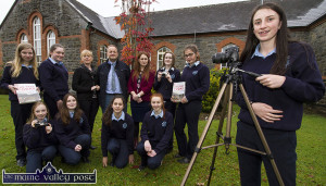 Lauren Butler on camera at the announcement of St. Joseph's Presentation Secondary School's participation in the 'Different Lenses' North / South History Project. Included are front from left: Shauna Curtin, Alison Ward, Ellen Dennehy and Gráinne O'Connor. Back from left: Siobhán Brosnan, Ava O'Flaherty, with teachers:  Noreen O'Shea, Pádraig Kelleher, deputy principal; Katie O'Reilly, Laura O'Shea and Grace Daly. ©Photograph:  John Reidy