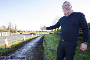 On home turf: Cllr. Bobby O'Connell pointing out the beginning of the work to surface the path from Knockananlig to Tullig. ©Photograph: John Reidy