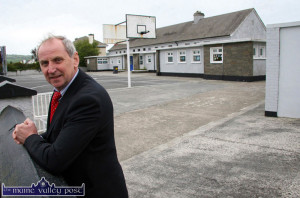 It's all behind him: Retired Principal, Denis Griffin received a gift of a Kerry Cow from his colleagues on his retirement from Scoil Naomh Chárthaigh on Thursday. ©Photograph: John Reidy